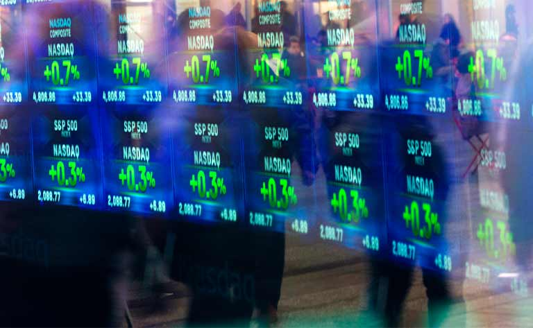 Stocks displayed on a screen on a trading floor