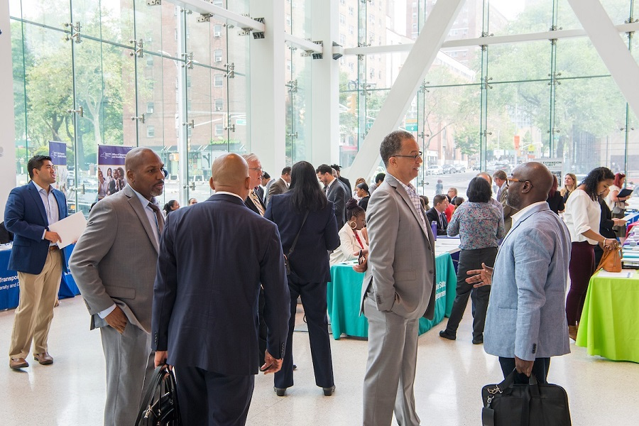 People gather at a MWBE event
