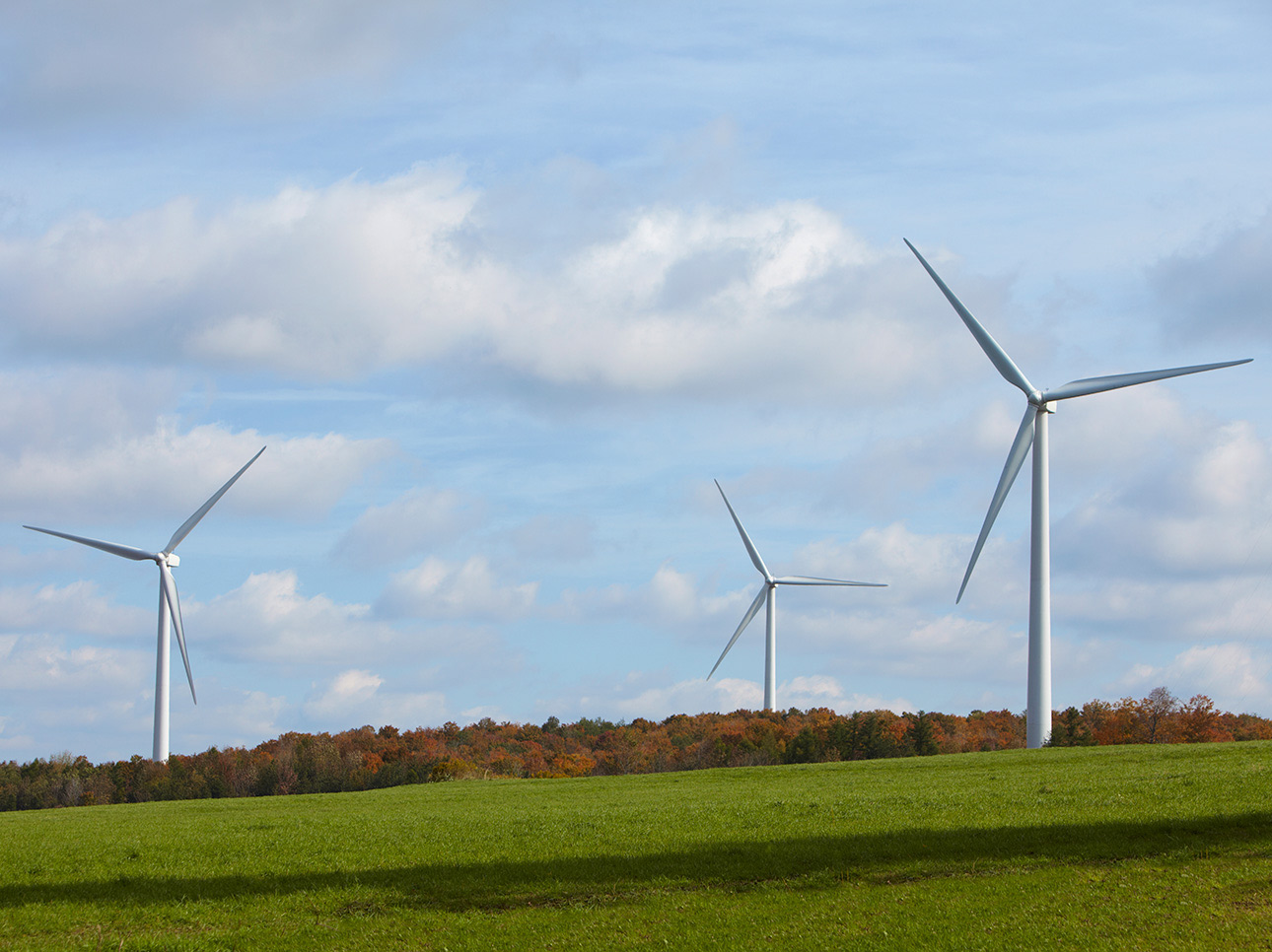 Three wind turbines in a large field
