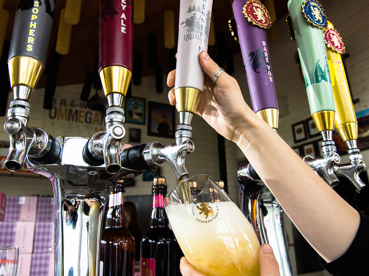 A beer brewed at the Ommegang Brewery in Cooperstown, New York being poured from tap.