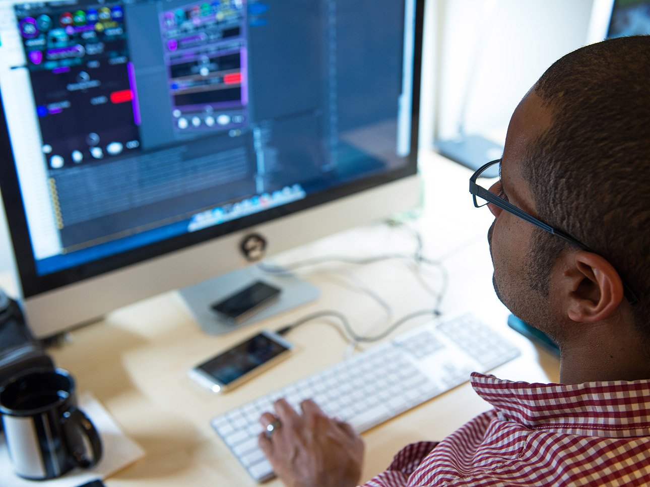Man working with digital software at desk