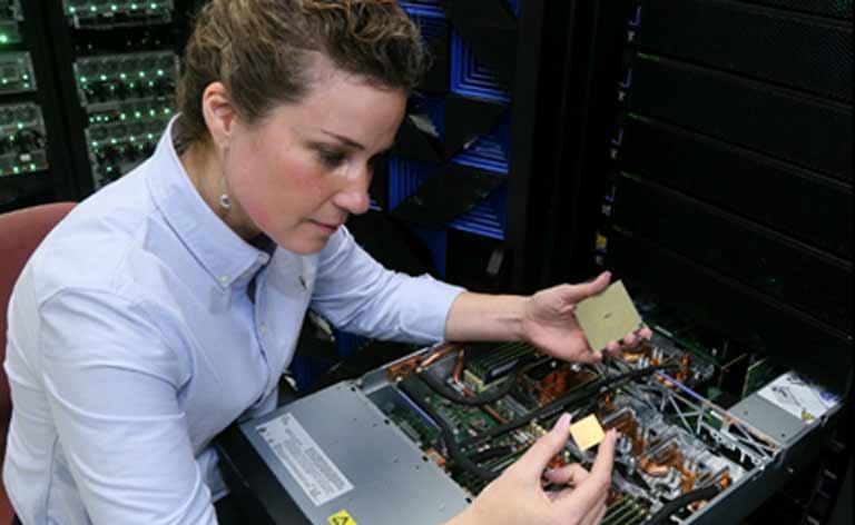IBM worker analyzing computer chips.